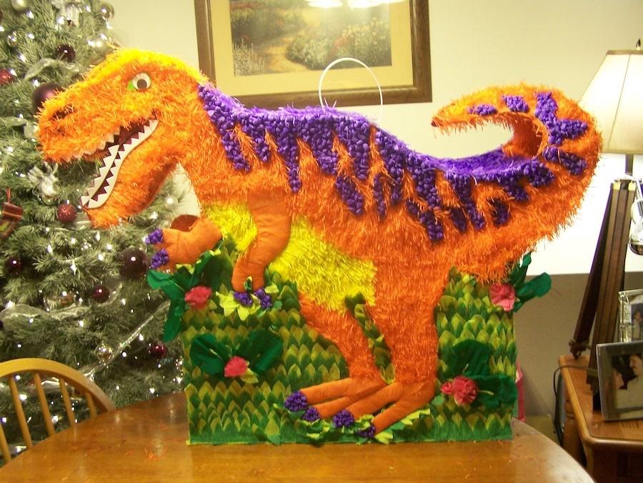 Piñatas de dinosaurios naranja piñata